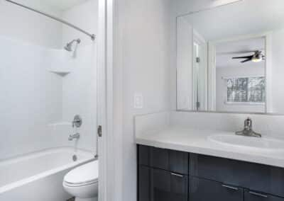 Bathroom showing a white sink, toilet and bathtub