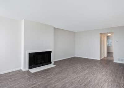 Empty living room with wood floors and fireplace