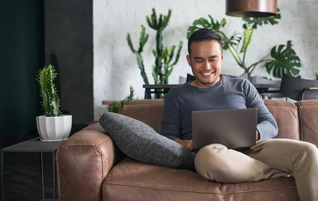 Man paying online using laptop
