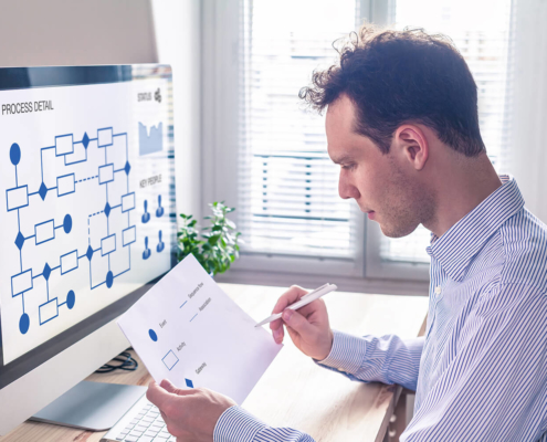 Document Automation Businessman or engineer working on business process automation or algorithm