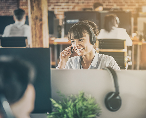 Helpdesk Solutions Call center worker accompanied by her team