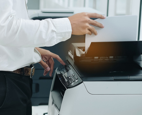 Office Copiers Printers Bussiness man Hand press button on panel of printer scanner or laser copy machine in office