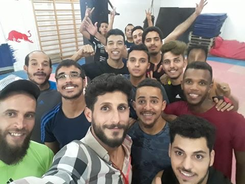 This image has an empty alt attribute; its file name is Libya-indoors-with-guys-5.jpg
