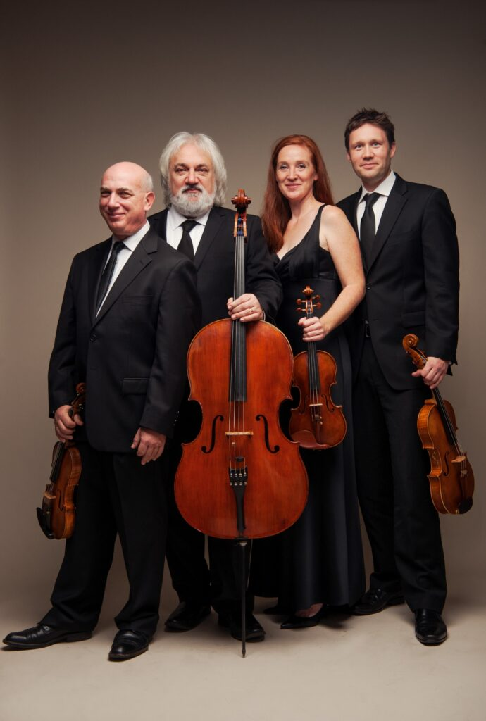 Group photo of the North Hollywood String Quartet, classical musicians in formal attire.