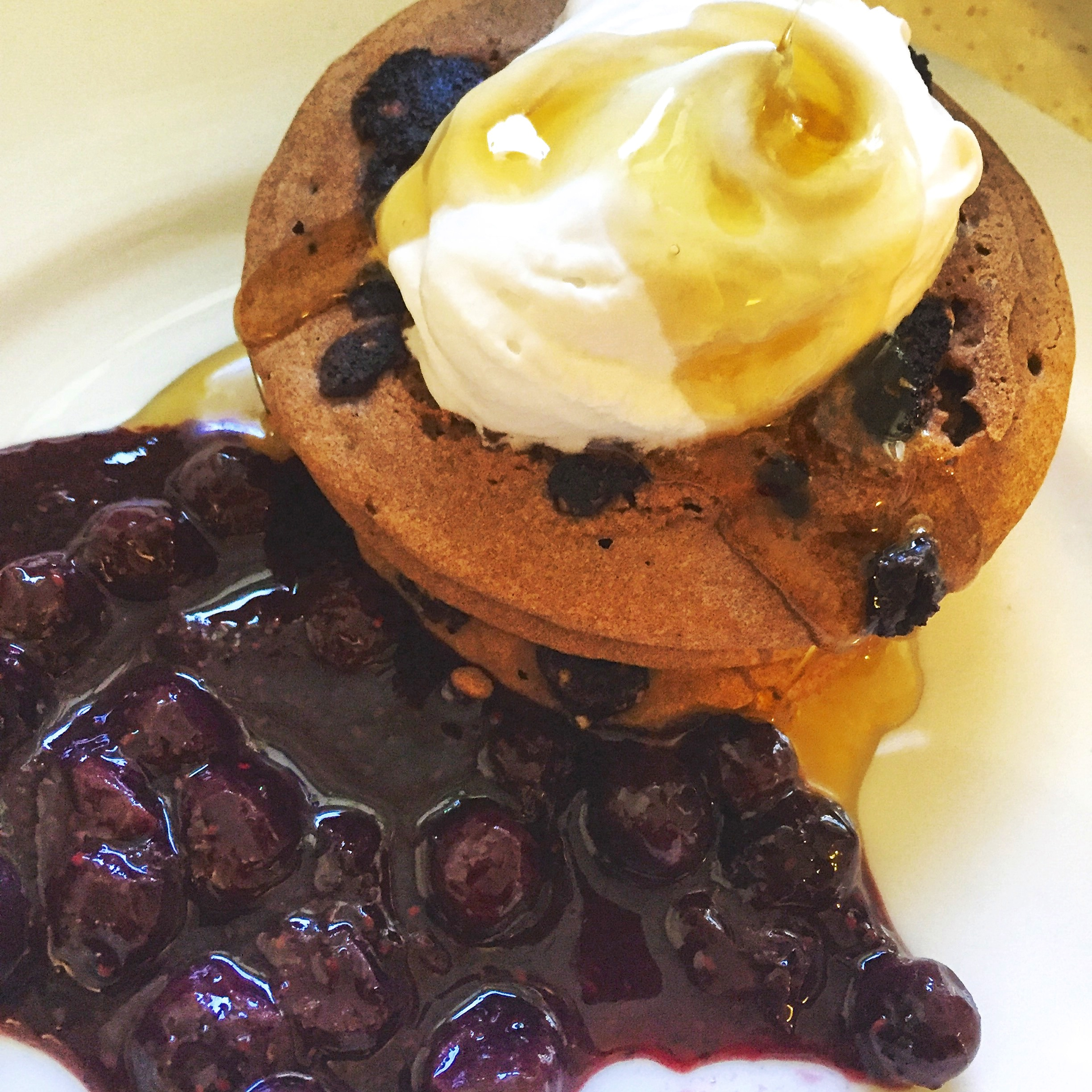 Teff Flour Pancakes with Blueberry-Chia Seed Compote & Coconut Whipped Cream