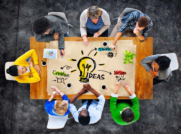 image of group sitting around ideas