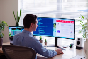 man in front of computer working remotely