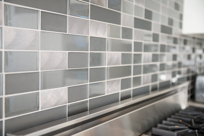 Our statement in the kitchen was the geo glass and metal subway tile.
