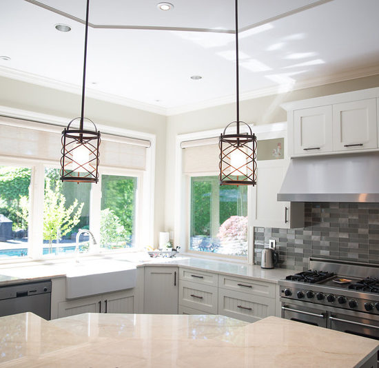 the addition of pendant lights over the island created dimension and interest to this area.