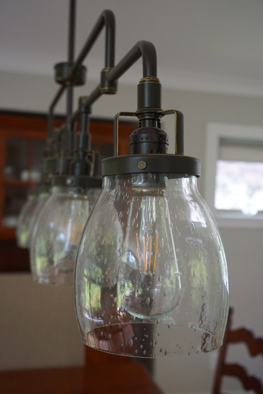 Curved and clear seeded glass shades complete the look with a hint of vintage inspiration.