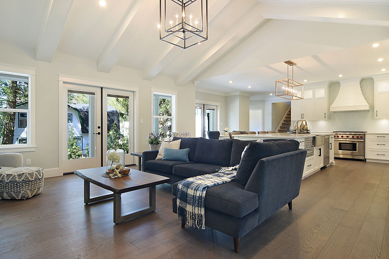 Vaulted ceilings and ceiling beams in the great room combine traditional design elements with a classic bright living space.