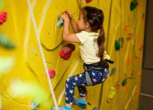 little girl rock climbing