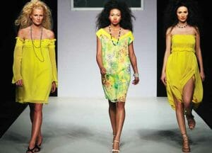 three women in yellow dresses