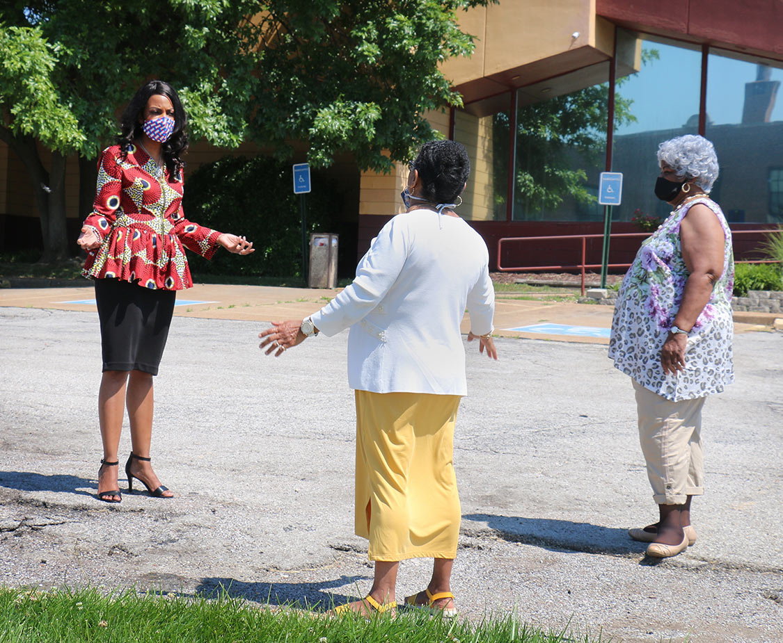 Tishaura Jones, running for Mayor of the City of St. Louis, talks with community members