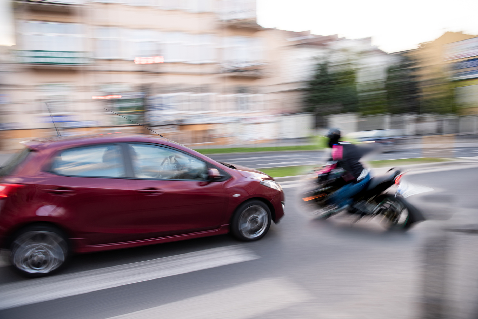 motorcycle rider about to be hit by car