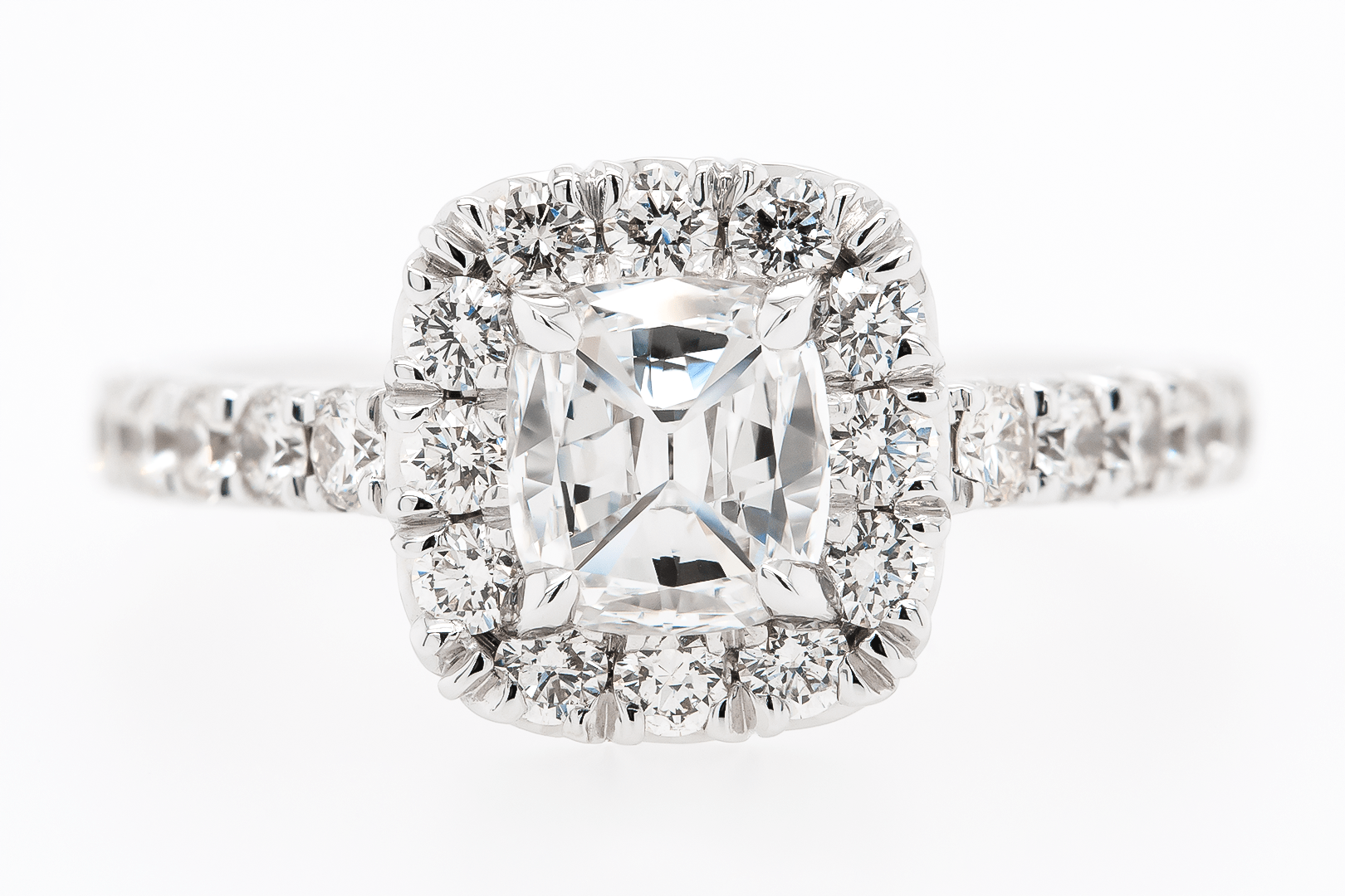 White Gold Halo Engagement Ring with diamonds on the band