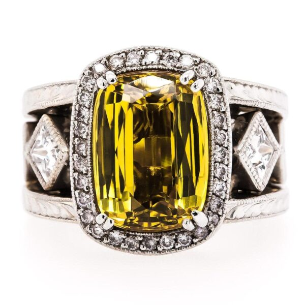 18 Karat White Gold Luxury Ring with a 0.60 Yellow Sapphire Stone in the center