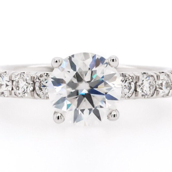 14 karat white gold side stone setting engagement ring with a 2.01 carat round diamond