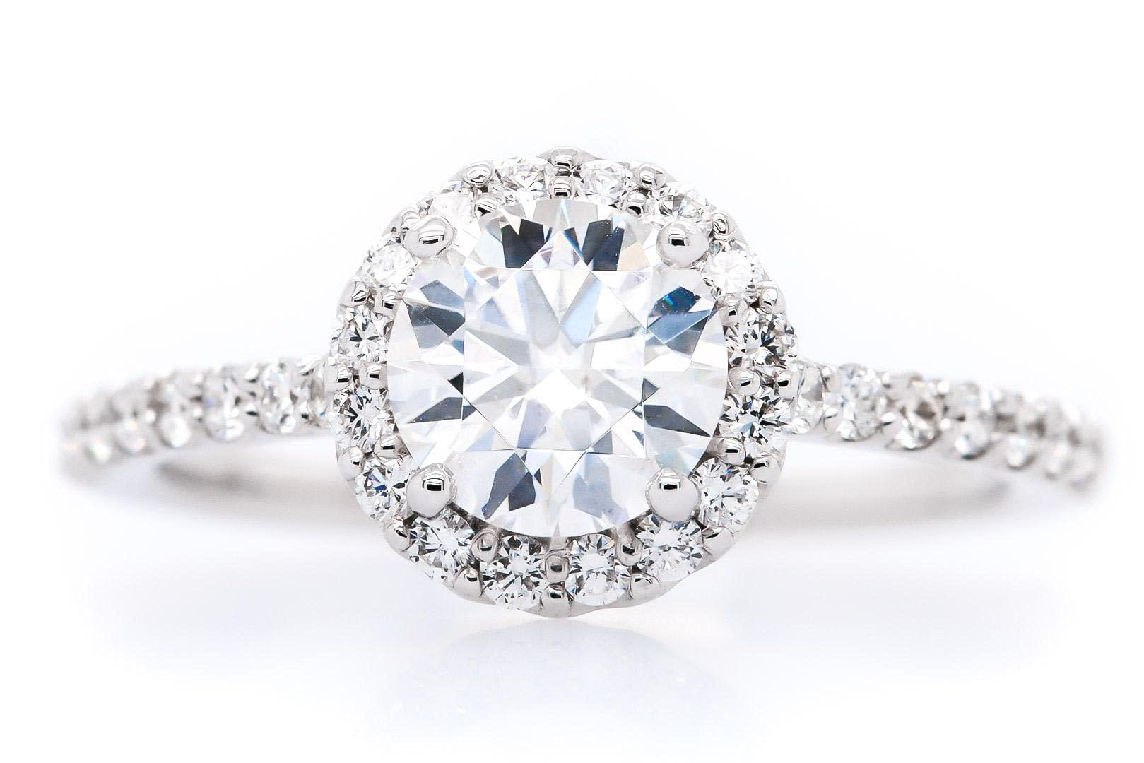 14 Karat White-Gold Halo Side Setting Engagement Ring with a 0.36 Carat setting around the Beautiful 1.35 Carat Round Cut Diamond in the Center.