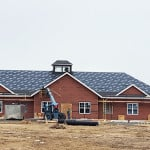The roof is almost finished on our new building, doesn't she look great!?