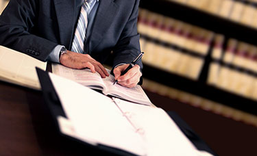 Photo of legal work being done in front of law books for Business Law by Corporate Lawyers in PA and NJ
