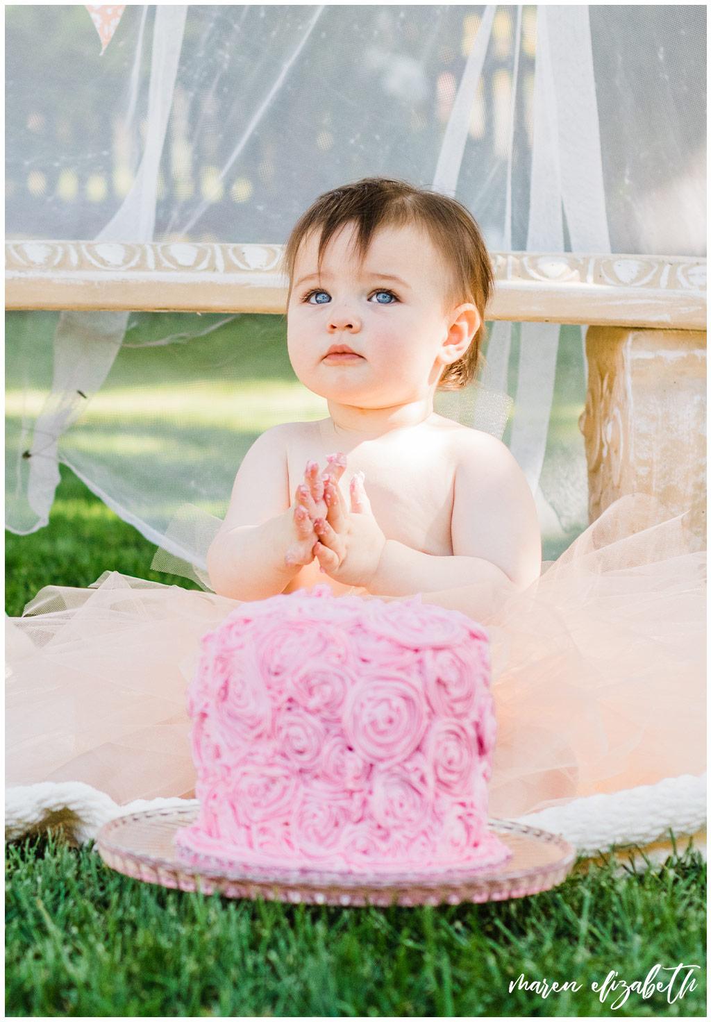 DIY Little Girl Cake Smash | Emi's one year old cake smash had a cute little girl theme. We got the decorations on the facebook marketplace and I made the cake myself. | Arizona Family Photographer | Maren Elizabeth Photography