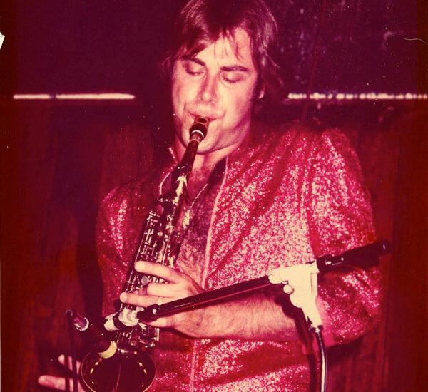 tom playing saxophone