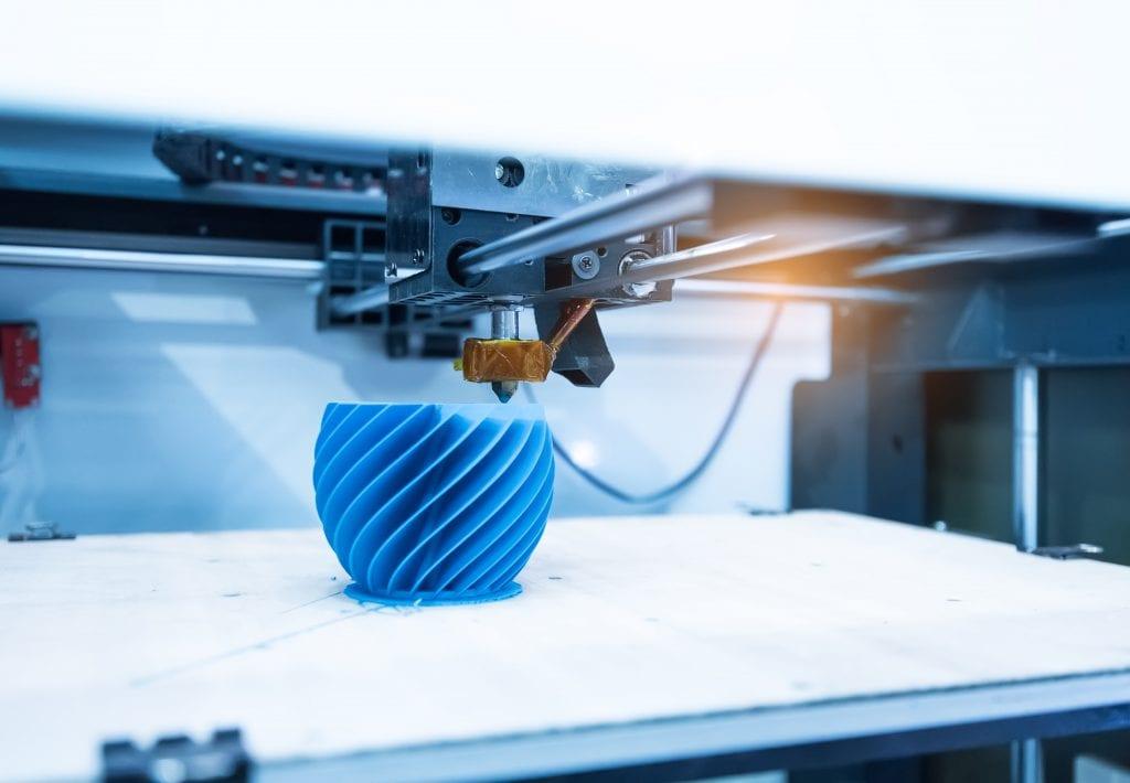 3D printer printing blue wavy shaped part