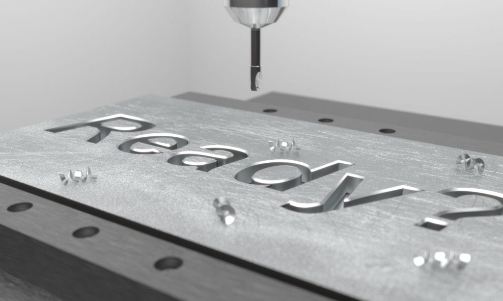 "CNC mill engraving the word ""Ready"" into a metal plate"