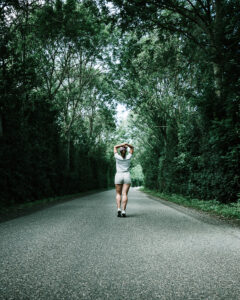 woman-in-white-t-shirt-walking-on-concrete-road-2792083_edited