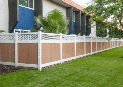 Fenced backyard space with grass and trees