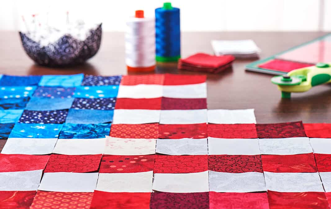 usa flag out of several papers