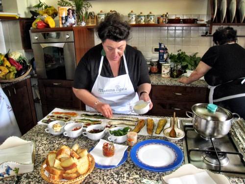 Mamma Agata preparing eggplant rolls