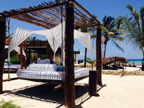 Day beds set up for casual beachfront lingering