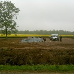 Against the backdrop of the blooming fields of rapeseed, the concrete base for the Memorial is being built.