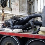 Statue on lorry in transit