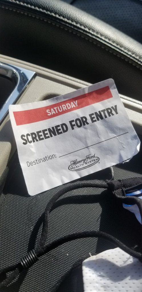 """picture of a """"screened for entry"""" name badge."""