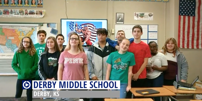 Derby Middle School takes time out to do a promotional spot for a school vendor.