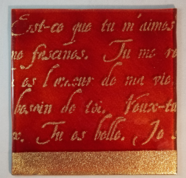 gold and red perisian writing