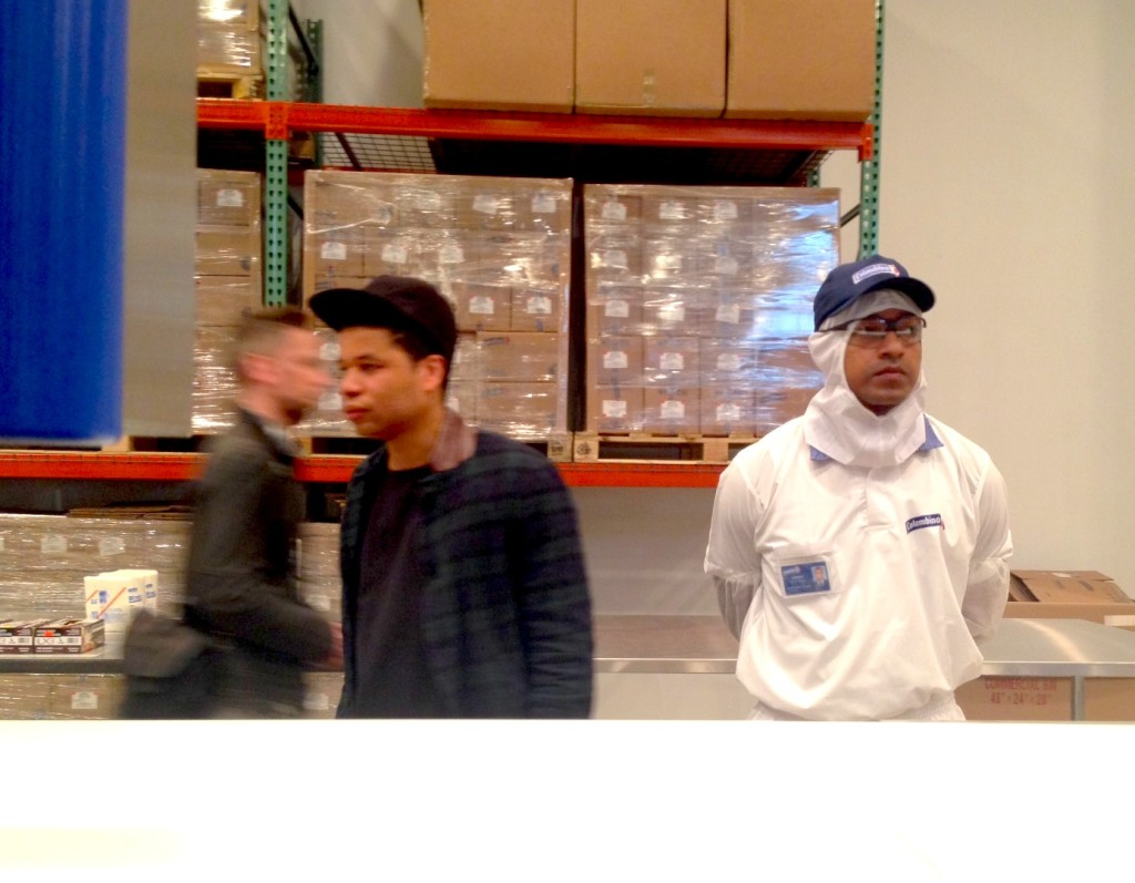 Oscar Murillo (center,left) and a Colombina factory worker (right), A Mercantile Novel David Zwirner, New York Photograph by Katy Hamer, 2014