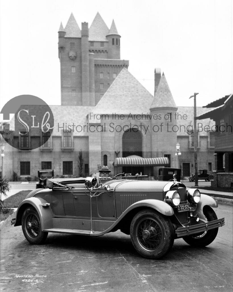 Parked in front of the Pacific Coast Club, 1927