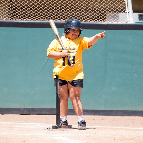softball athlete pointing at where she wants to hit the ball