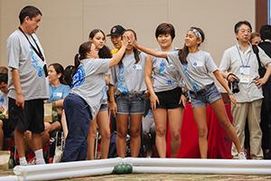 volunteers high-fiving athletes