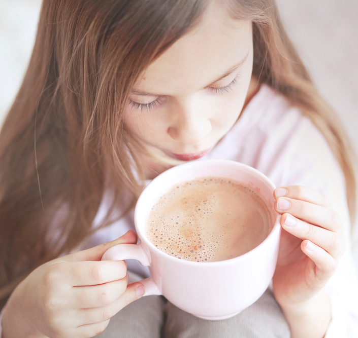 girl drinking hot cocoa from the big pink cup2