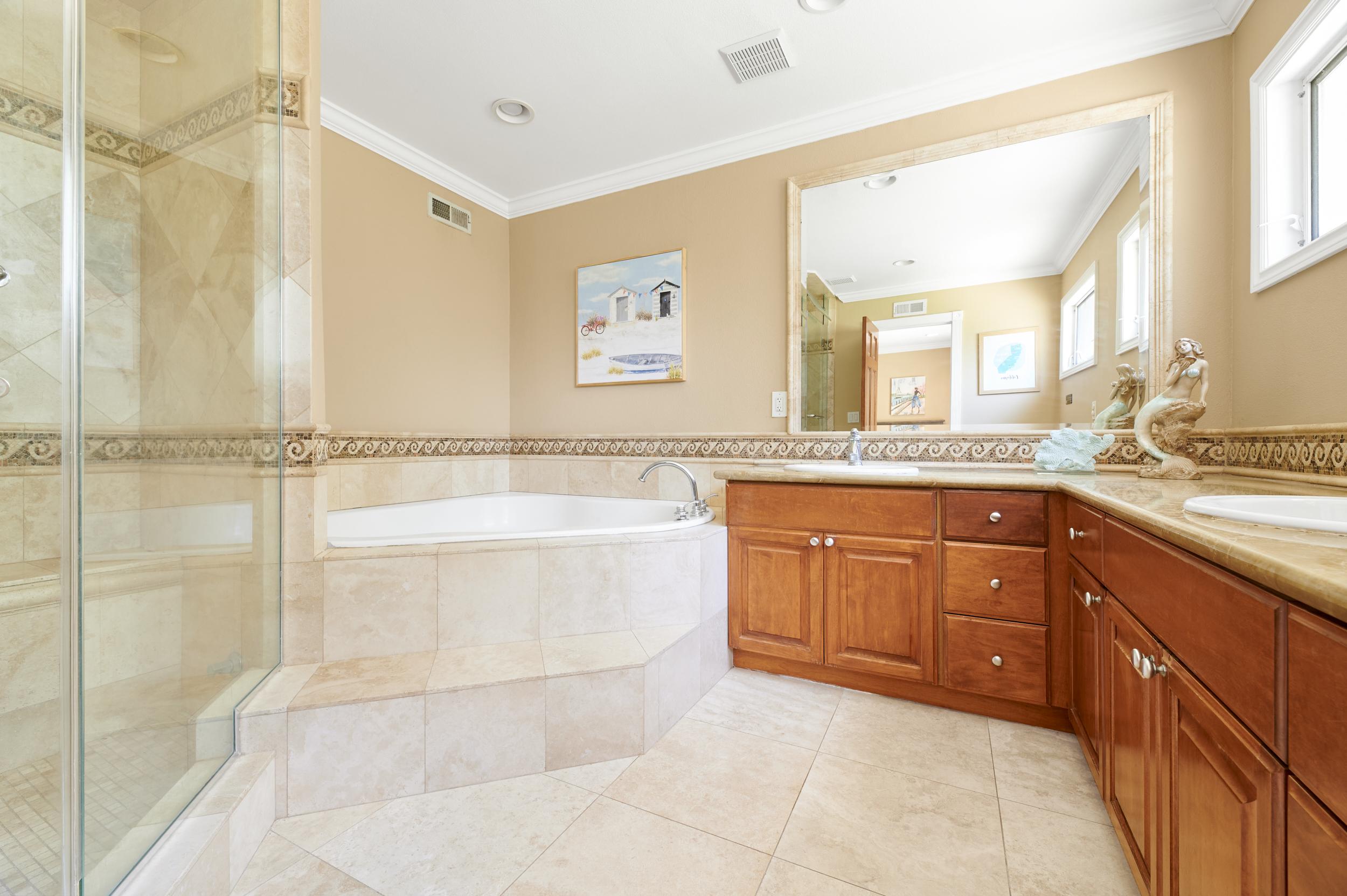 https://secureservercdn.net/198.71.233.107/zgw.2cd.myftpupload.com/wp-content/uploads/2020/08/Gratitude-Lodge-Newport-BeachGround-Floor-Master-Bedroom-Bathroom.jpg?time=1607134972