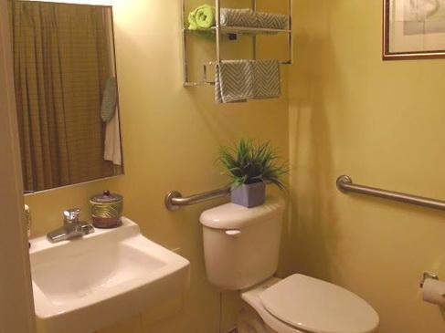 A bathroom in Azalea Gardens resort residence with