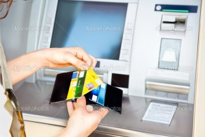 Woman has cash withdrawal with Visa card  into the ATM