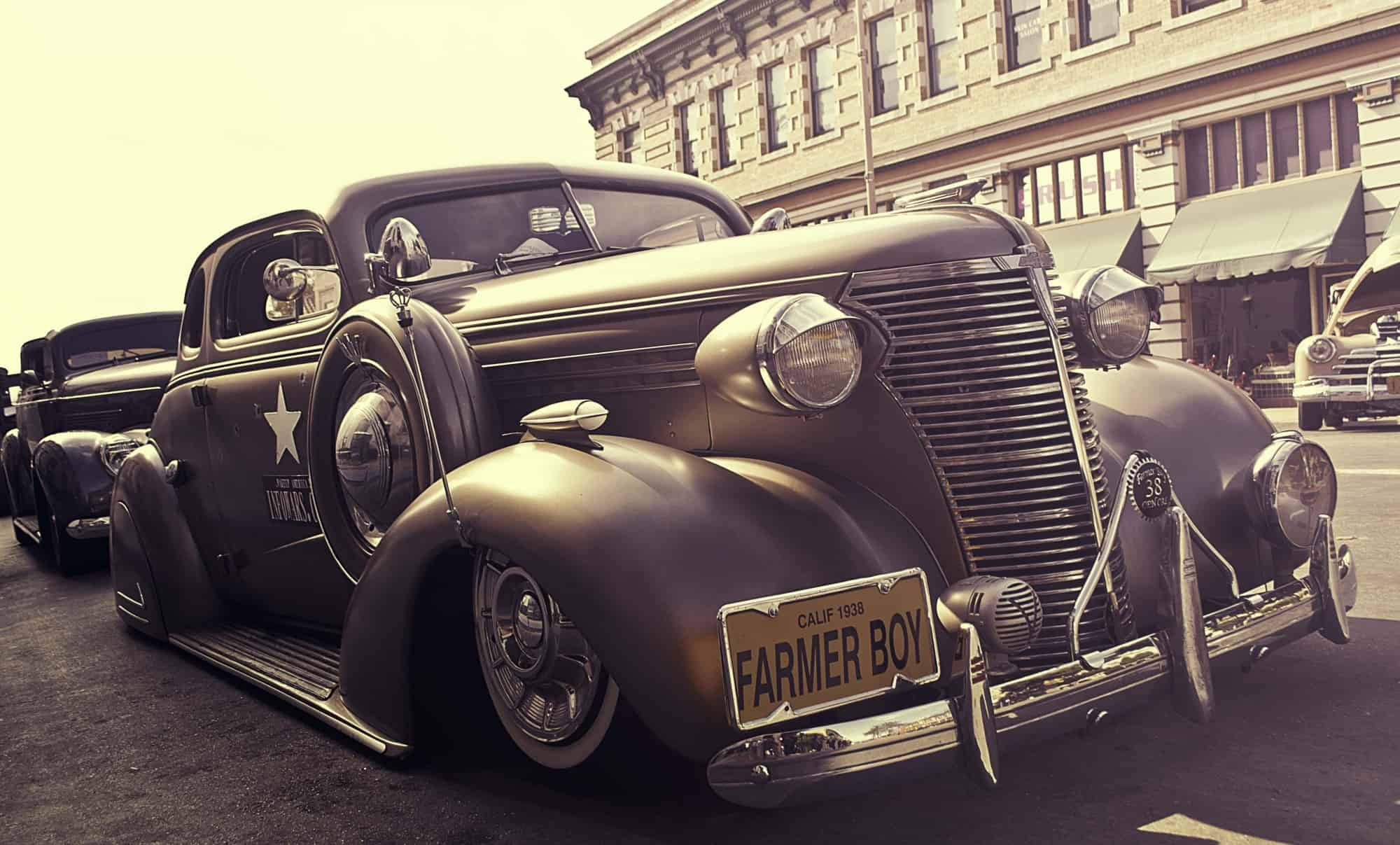 vintage car with farmer boy license plates
