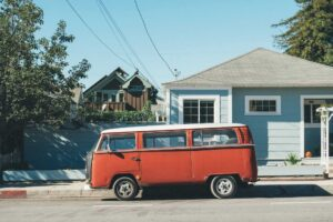 old van in front of a small house