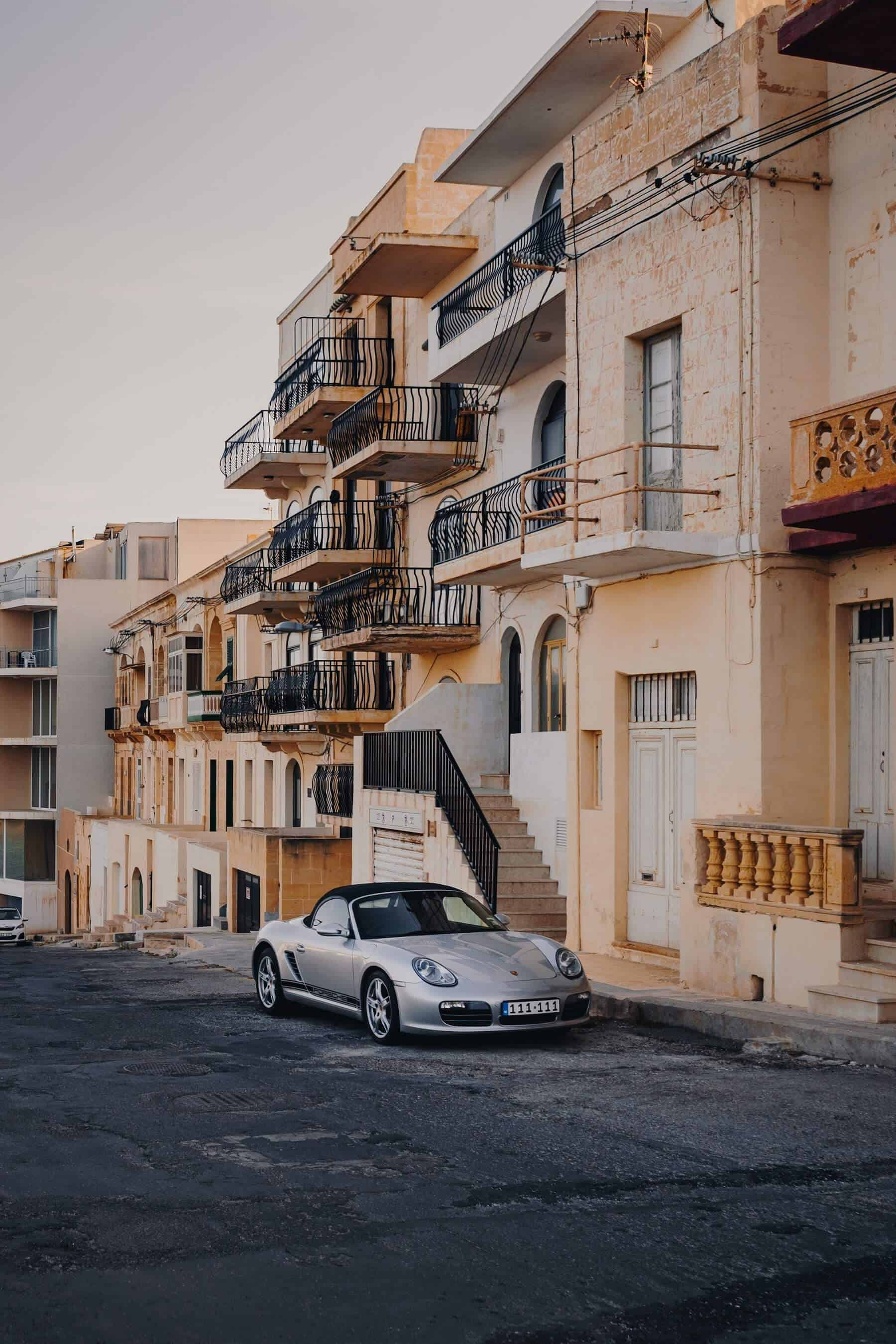 sports car parked in front of a house